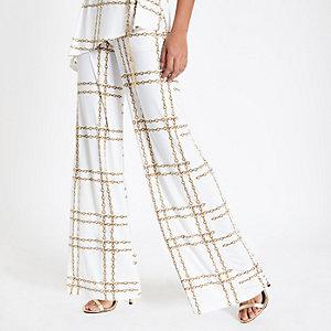 Pantalon évasé imprimé chaîne blanc