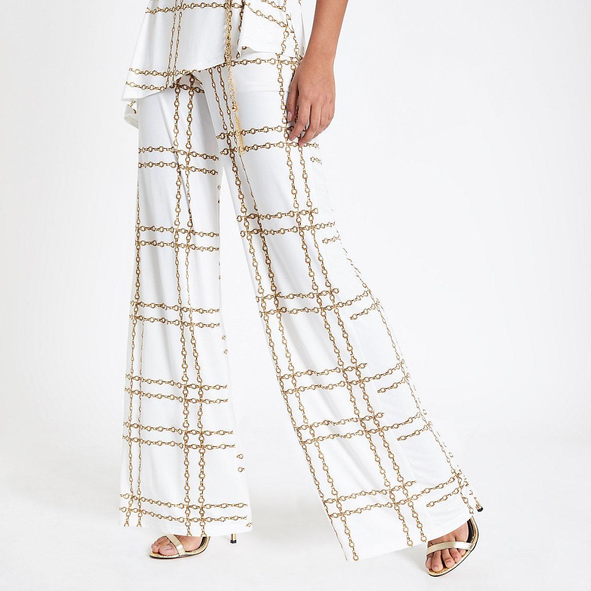 White chain print flared trousers