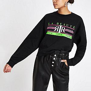 Zwart sweatshirt met neon 'La beaute'-print