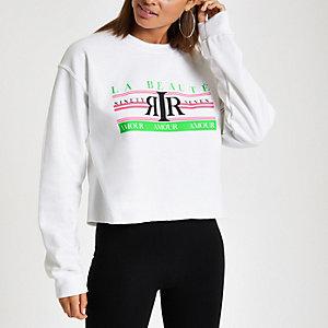Wit sweatshirt met neon 'La beaute'-print