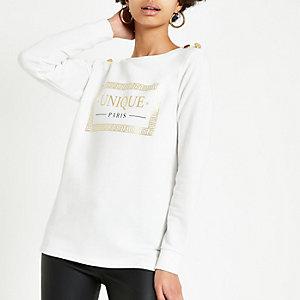 Wit sweatshirt met 'Liberte'-print en knopen op de schouder