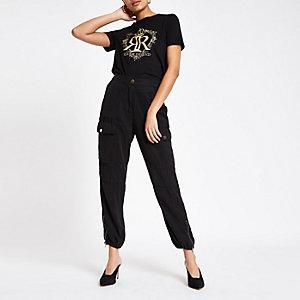 Zwart T-shirt met kroonfolieprint en RI-logo