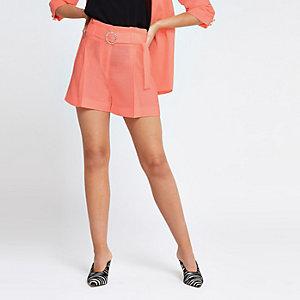 Neon orange belted shorts