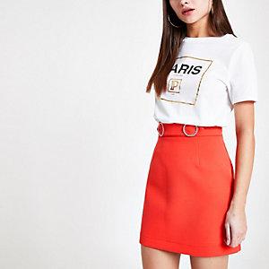 Coral rhinestone trim mini skirt