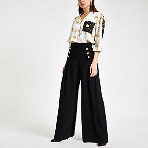 Zwarte broek met wijde plissé pijpen
