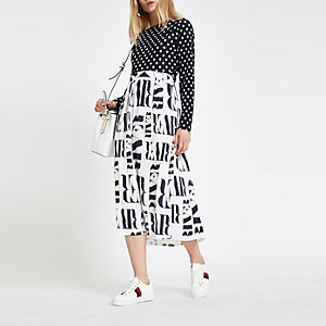 White satin RI print pleated midi skirt