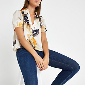 Cream floral V neck shell top