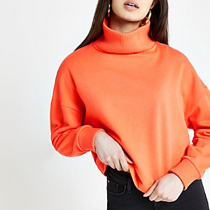 Orange ribbed high neck jumper