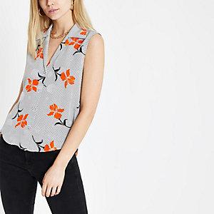 Ärmelloses Hemd mit Blumen- und Punktmuster in Orange