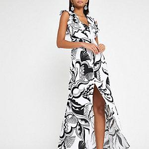 Schwarzes Kleid mit Print und geschlitztem Saum