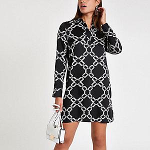 Schwarzes Blusenkleid mit Print