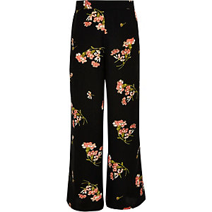 Girls black floral print palazzo trousers