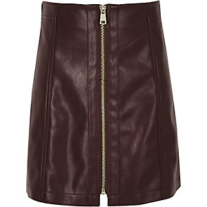 Girls dark purple leather look zip mini skirt