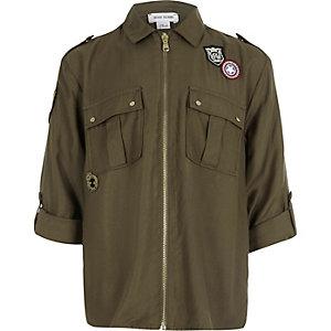 Kaki overhemd met badges en rits voor