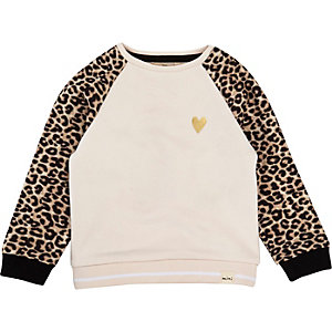 Pull rose à manches léopard mini fille