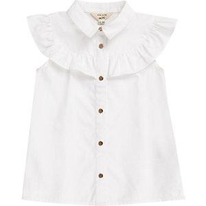 Chemise blanche sans manches bordée de volants mini fille