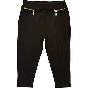 Schwarze Leggings mit Reißverschluss