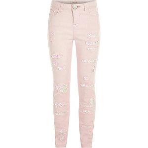 Paillettenverzierte Skinny Jeans in Hellrosa im Used-Look