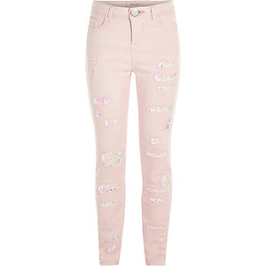 Girls light pink ripped skinny sequin jeans