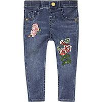 Blaue Skinny Jeans mit Blumenmuster