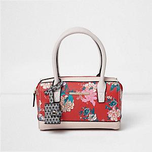 Rote Handtasche mit Blumenmuster