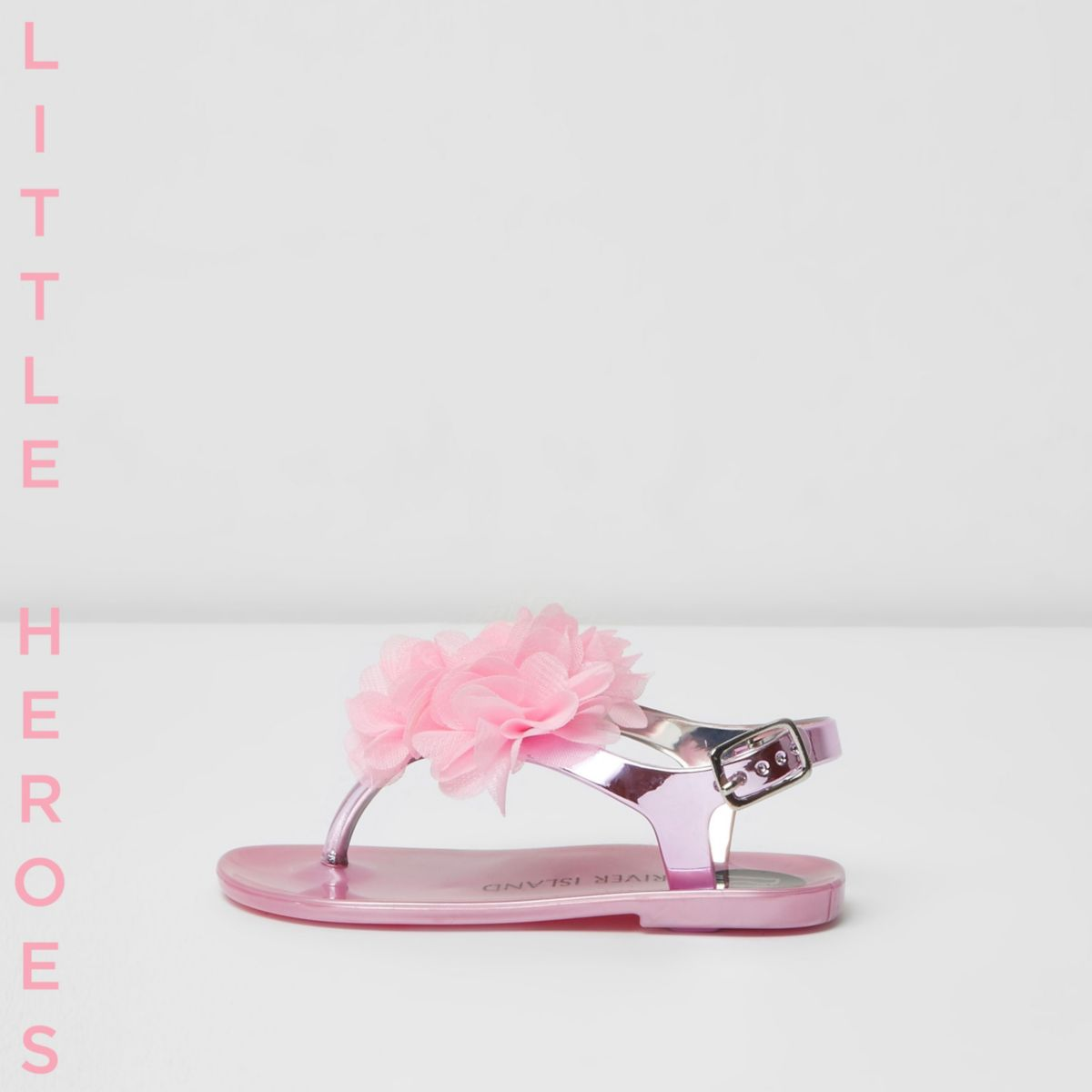 Lila Jelly-Sandalen mit Zierblume
