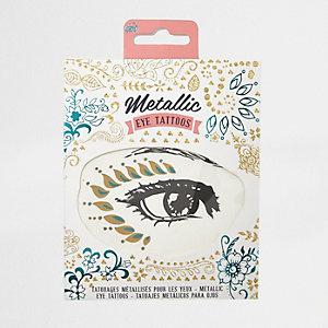 Girls metallic eye tattoos