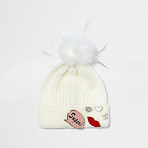Girls cream knit badge bobble hat