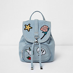 Girls blue denim badge backpack