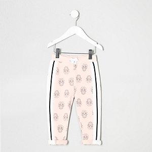 Pantalon de jogging à imprimé tête de mort rose mini fille