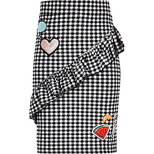 Girls black gingham frill badge skirt