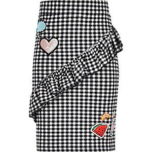 Girls black gingham frill badge skirt