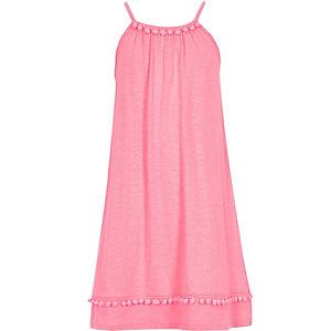 Robe trapèze rose bordée de pompons pour fille