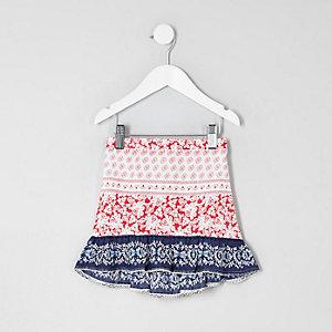 Jupe imprimée rouge et bleue à volants mini fille