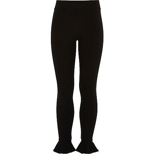 Girls black frill hem leggings