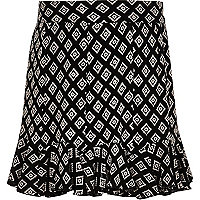 Girls black mono print flippy skirt