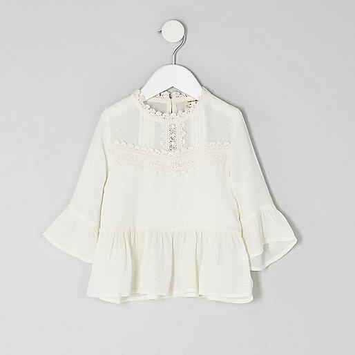 Mini girls cream lace peplum hem top
