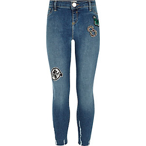 Girls blue badge chewed hem skinny jeans