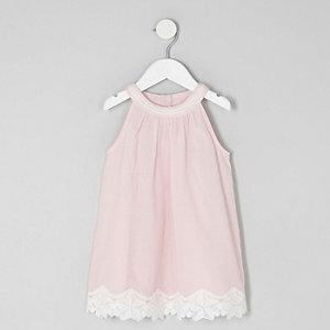 Pinkes Trapez-Kleid mit Spitzenbesatz