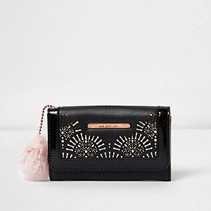 Girls black laser cut pom pom purse