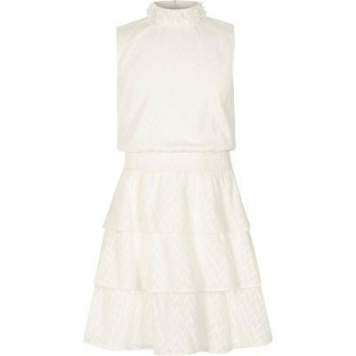 River Island Hoogsluitende mouwloze jurk met strokenrok voor meisjes
