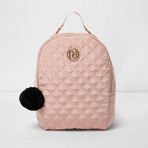 Girls pink RI quilted backpack with pom pom