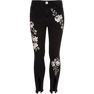 Amelie - Zwarte jeans met bloemenprint en split in de zoom voor meisjes