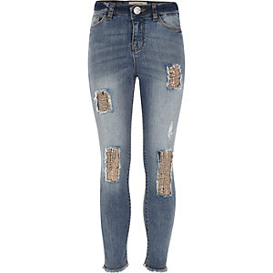 Amelie - Blauwe skinny jeans met patches en lovertjes