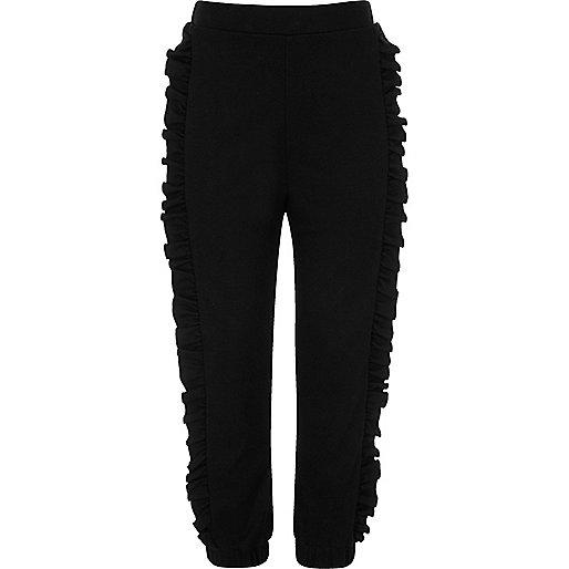 Girls black frill side pants