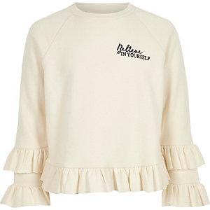 Crème gerafeld sweatshirt met 'Believe'-print