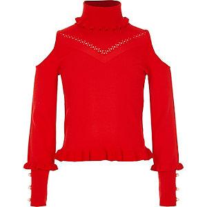 Roter Pullover mit Schulterausschnitten und Perlenverzierung