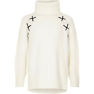 Girls cream roll neck cross detail jumper