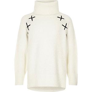 Girls cream roll neck cross detail jumper