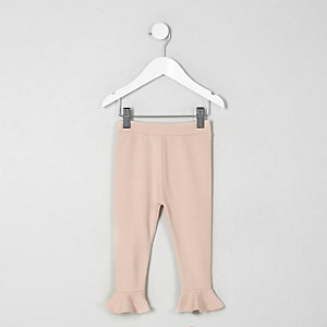 Legging rose à volants sur l'ourlet mini fille